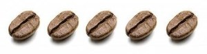 Coffee beans , identical , in a row