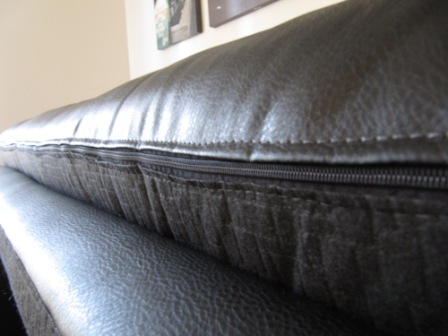 The queen cushion on the couch has a zipper around it